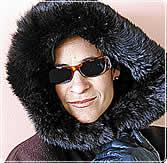 A woman wears a fur coat.